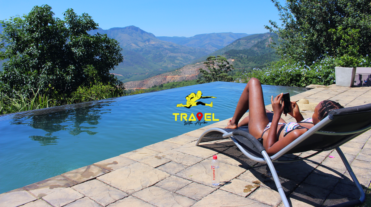 Limpopo magoebaskloof accommodation | infinity pool South Africa | luxury travel package South Africa | thirsti water | group travel package limpopo | © Travel With Afrika